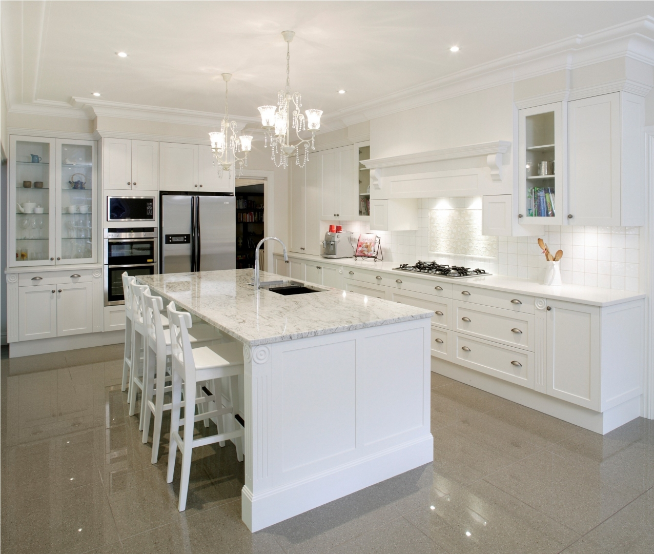 White Kitchens the all white kitchen allows colorful patterns on the tiled backsplash windows rug and dishes in the lighted islands to get the attention they deserve White Kitchen